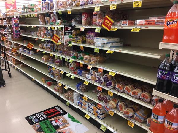 "<div class=""meta image-caption""><div class=""origin-logo origin-image wtvd""><span>WTVD</span></div><span class=""caption-text"">Bread is flying off the shelves at Food Lion! (Raymond A. Rodriguez/ABC11 Eyewitness)</span></div>"