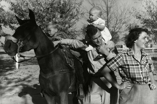 <div class='meta'><div class='origin-logo' data-origin='none'></div><span class='caption-text' data-credit='Conde Nast via Getty Images'>George H. W. Bush with his wife, Barbara, and their children Pauline and George W. on horse in the yard of their Midlands, Texas ranch.</span></div>