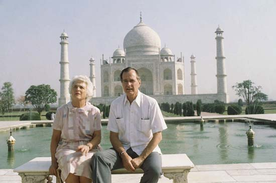 <div class='meta'><div class='origin-logo' data-origin='none'></div><span class='caption-text' data-credit='ASSOCIATED PRESS'>U.S. Vice President George H. W. Bush, right, and his wife Barbara Bush pose in front of the Taj Mahal on Saturday, May 13, 1984, Agra, India. (AP Photo/Sondeep Shankar)</span></div>