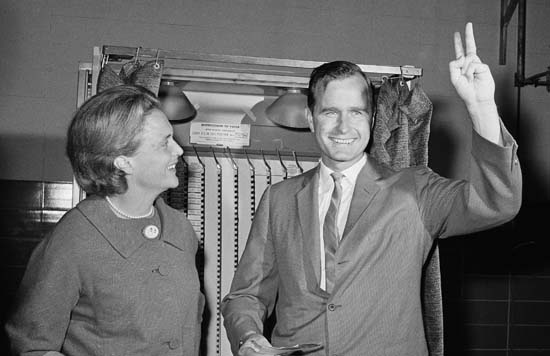 <div class='meta'><div class='origin-logo' data-origin='none'></div><span class='caption-text' data-credit='AP'>Senate candidate George Bush shows a victory sign as he and his wife Barbara stand in front of a vote machine November 3, 1964 in Houston just before casting their ballot.</span></div>