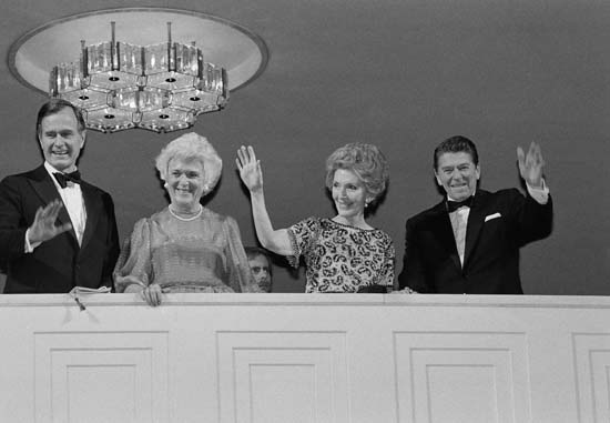 <div class='meta'><div class='origin-logo' data-origin='none'></div><span class='caption-text' data-credit='AP'>President-elect Ronald Reagan and his wife Nancy wave from the balcony at the Kennedy Center on Jan. 18, 1981, where they attended a concert George H.W. Bush and his wife Barbara.</span></div>