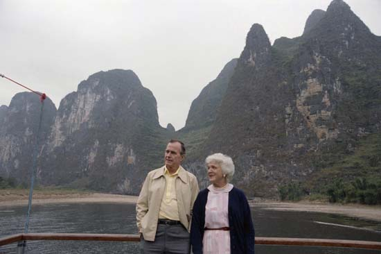 <div class='meta'><div class='origin-logo' data-origin='none'></div><span class='caption-text' data-credit='AP'>U.S. Vice-President George H.W. Bush and wife Barbara Bush as they toured the Guilin area, Oct. 13, 1985 in China. (AP Photo/Neal Ulevich)</span></div>