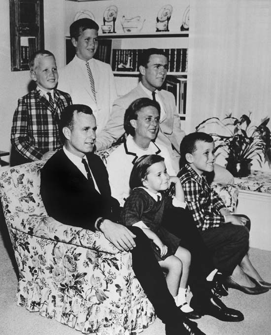 <div class='meta'><div class='origin-logo' data-origin='none'></div><span class='caption-text' data-credit='AP'>In this 1964 file photo, George H.W. Bush sits on couch with his wife Barbara and their children. George W. Bush sits at right behind his mother. Behind couch are Neil and Jeb</span></div>