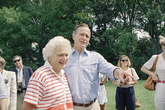 <div class='meta'><div class='origin-logo' data-origin='none'></div><span class='caption-text' data-credit='AP'>VP George H.W. Bush, right, and his Barbara Bush talk to reporters after a press conference outside their home, Sept. 3, 1988, Washington, D.C. Bush said he was standing</span></div>