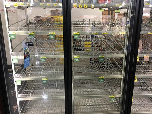 "<div class=""meta image-caption""><div class=""origin-logo origin-image wtvd""><span>WTVD</span></div><span class=""caption-text"">The run on milk has commenced at Harris Teeter in Holly Springs. (Greg Creten/ABC11 Eyewitness)</span></div>"