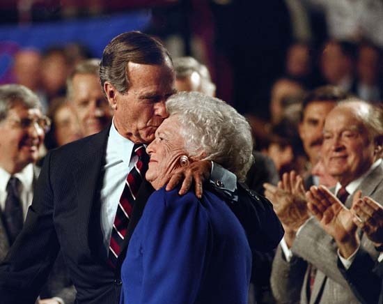 <div class='meta'><div class='origin-logo' data-origin='none'></div><span class='caption-text' data-credit='ASSOCIATED PRESS'>Entertainer Bob Hope applauds as President George H. W. Bush kisses his wife Barbara during a pre-election rally at the Astro Arena in Houston in this Nov. 2, 1992 file photo.</span></div>