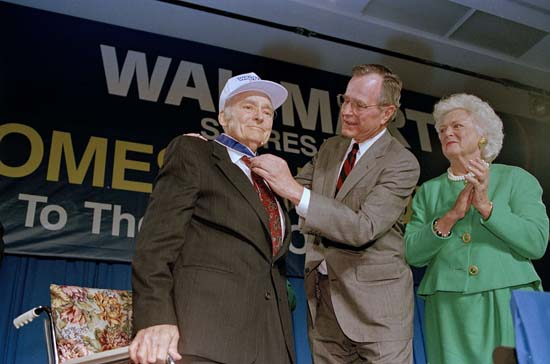 <div class='meta'><div class='origin-logo' data-origin='none'></div><span class='caption-text' data-credit='AP'>President George Bush awards Sam Walton the Medal of Freedom as first lady Barbara Bush looks on during ceremonies at Wal-Mart headquarters in Bentonville, Ark., March 17, 1992.</span></div>