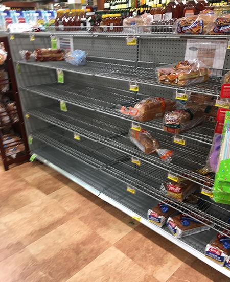 "<div class=""meta image-caption""><div class=""origin-logo origin-image wtvd""><span>WTVD</span></div><span class=""caption-text"">This was the bread aisle at the Cary Harris Teeter near Cary Towne Center on Thursday night. (Stephanie Webb/ABC11 Eyewitness)</span></div>"