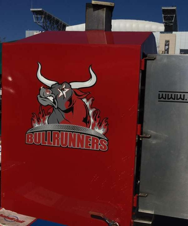 <div class='meta'><div class='origin-logo' data-origin='none'></div><span class='caption-text' data-credit=''>The &#34;Bull Runners&#34; tailgate outside NRG Stadium.</span></div>
