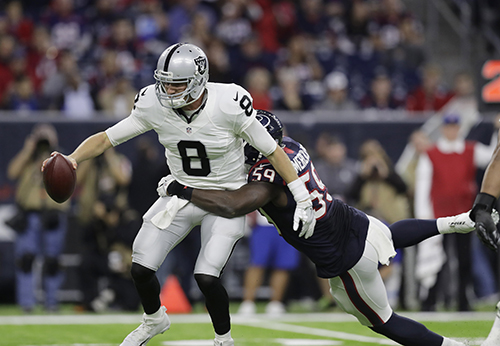 "<div class=""meta image-caption""><div class=""origin-logo origin-image ap""><span>AP</span></div><span class=""caption-text"">Oakland Raiders quarterback Connor Cook (8) is sacked by Houston Texans outside linebacker Whitney Mercilus (59). (AP Photo/Eric Gay)</span></div>"