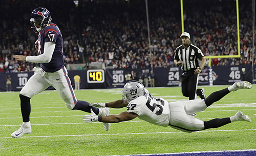 <div class='meta'><div class='origin-logo' data-origin='AP'></div><span class='caption-text' data-credit='AP Photo/Eric Gay'>Houston Texans quarterback Brock Osweiler (17) scores on a two-yard run against Oakland Raiders' Cory James (57).</span></div>
