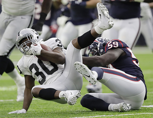 "<div class=""meta image-caption""><div class=""origin-logo origin-image ap""><span>AP</span></div><span class=""caption-text"">Houston Texans outside linebacker Whitney Mercilus (59) tackles Oakland Raiders defensive back SaQwan Edwards (30) during the first half. (AP Photo/Eric Gay)</span></div>"