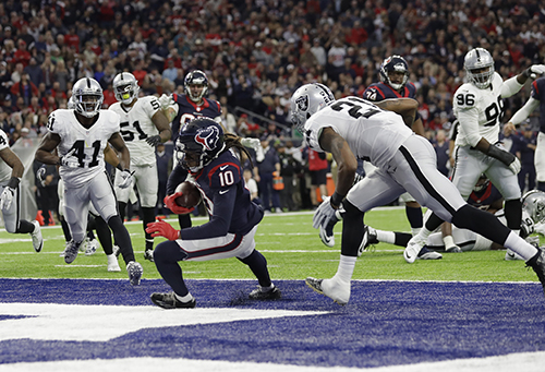 <div class='meta'><div class='origin-logo' data-origin='AP'></div><span class='caption-text' data-credit='AP Photo/Eric Gay'>Houston Texans wide receiver DeAndre Hopkins (10) makes a touchdown catch against Oakland Raiders cornerback Sean Smith (21).</span></div>