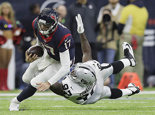 "<div class=""meta image-caption""><div class=""origin-logo origin-image ap""><span>AP</span></div><span class=""caption-text"">Houston Texans quarterback Brock Osweiler (17) scrambles for a first down against Oakland Raiders defensive end Mario Edwards (97). (AP Photo/Eric Gay)</span></div>"
