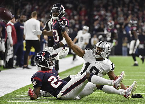 "<div class=""meta image-caption""><div class=""origin-logo origin-image ap""><span>AP</span></div><span class=""caption-text"">Oakland Raiders wide receiver Andre Holmes (18) calls for interference call against Houston Texans cornerback Johnathan Joseph (24). (AP Photo/Eric Gay)</span></div>"