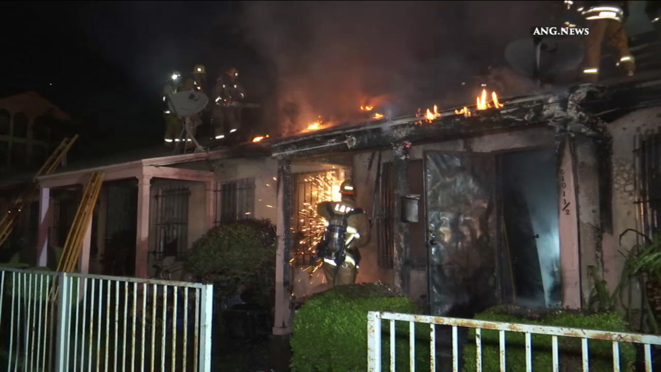 Los Angeles Fire Department firefighters battle a fire at a house in Hyde Park on Sunday, Jan. 8, 2017.