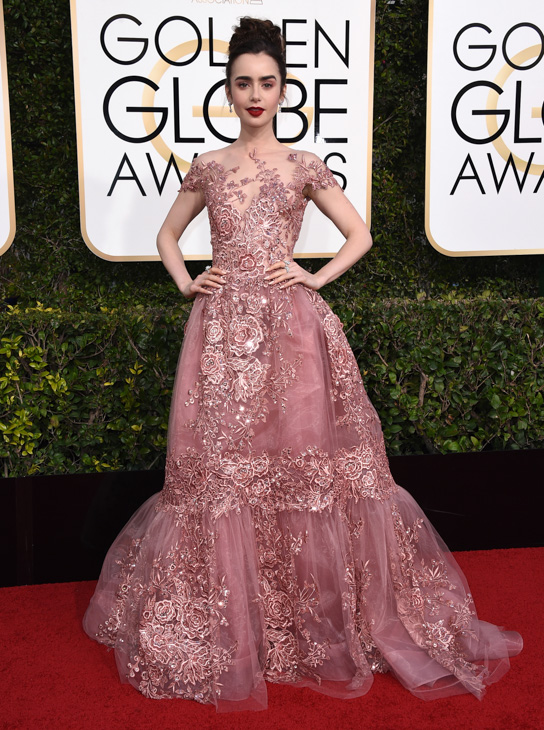 <div class='meta'><div class='origin-logo' data-origin='none'></div><span class='caption-text' data-credit='Jordan Strauss/Invision/AP'>Lily Collins arrives at the 74th annual Golden Globe Awards at the Beverly Hilton Hotel on Sunday, Jan. 8, 2017, in Beverly Hills, Calif.</span></div>