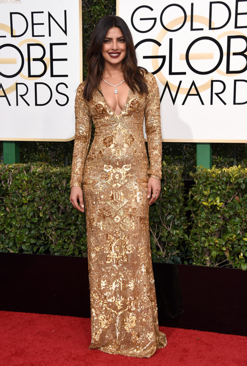 <div class='meta'><div class='origin-logo' data-origin='none'></div><span class='caption-text' data-credit='Jordan Strauss/Invision/AP'>Priyanka Chopra arrives at the 74th annual Golden Globe Awards at the Beverly Hilton Hotel on Sunday, Jan. 8, 2017, in Beverly Hills, Calif.</span></div>