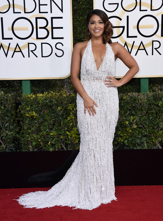 <div class='meta'><div class='origin-logo' data-origin='none'></div><span class='caption-text' data-credit='Jordan Strauss/Invision/AP'>Gina Rodriguez arrives at the 74th annual Golden Globe Awards at the Beverly Hilton Hotel on Sunday, Jan. 8, 2017, in Beverly Hills, Calif.</span></div>