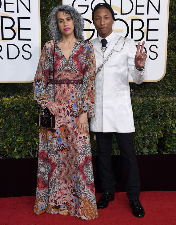 "<div class=""meta image-caption""><div class=""origin-logo origin-image none""><span>none</span></div><span class=""caption-text"">Mimi Valdes, left, and Pharrell Williams arrive at the 74th annual Golden Globe Awards at the Beverly Hilton Hotel on Sunday, Jan. 8, 2017, in Beverly Hills, Calif. (Jordan Strauss/Invision/AP)</span></div>"