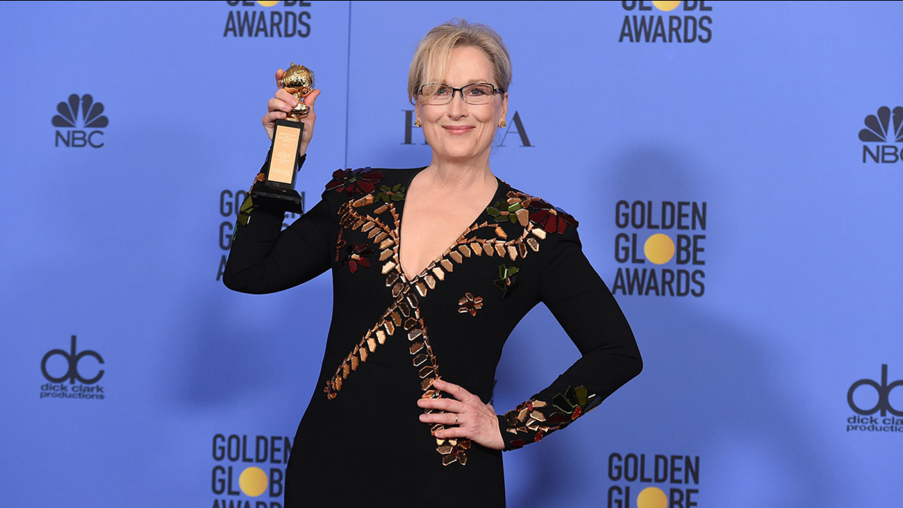 Meryl Streep poses with her lifetime achievement award backstage at the Golden Globe Awards in Beverly Hills on Sunday, Jan. 8, 2017.