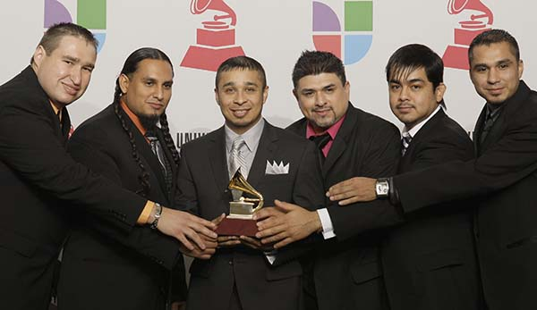 <div class='meta'><div class='origin-logo' data-origin='AP'></div><span class='caption-text' data-credit='AP Photo/David J. Phillip'>Siggno is seen with the best norteno album award backstage at the 9th annual Latin Grammy Awards on Thursday, Nov. 13, 2008 in Houston.</span></div>