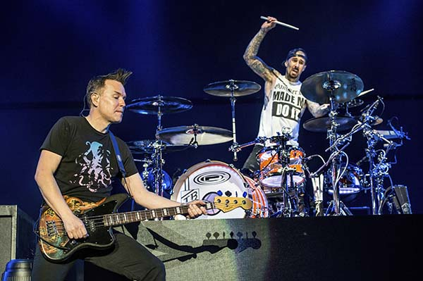 <div class='meta'><div class='origin-logo' data-origin='AP'></div><span class='caption-text' data-credit='Amy Harris/Invision/AP'>Mark Hoppus, left, and Travis Barker of blink-182 perform at the 2016 KROQ Almost Acoustic Christmas at The Forum on Saturday, Dec. 10, 2016, in Inglewood, Calif.</span></div>
