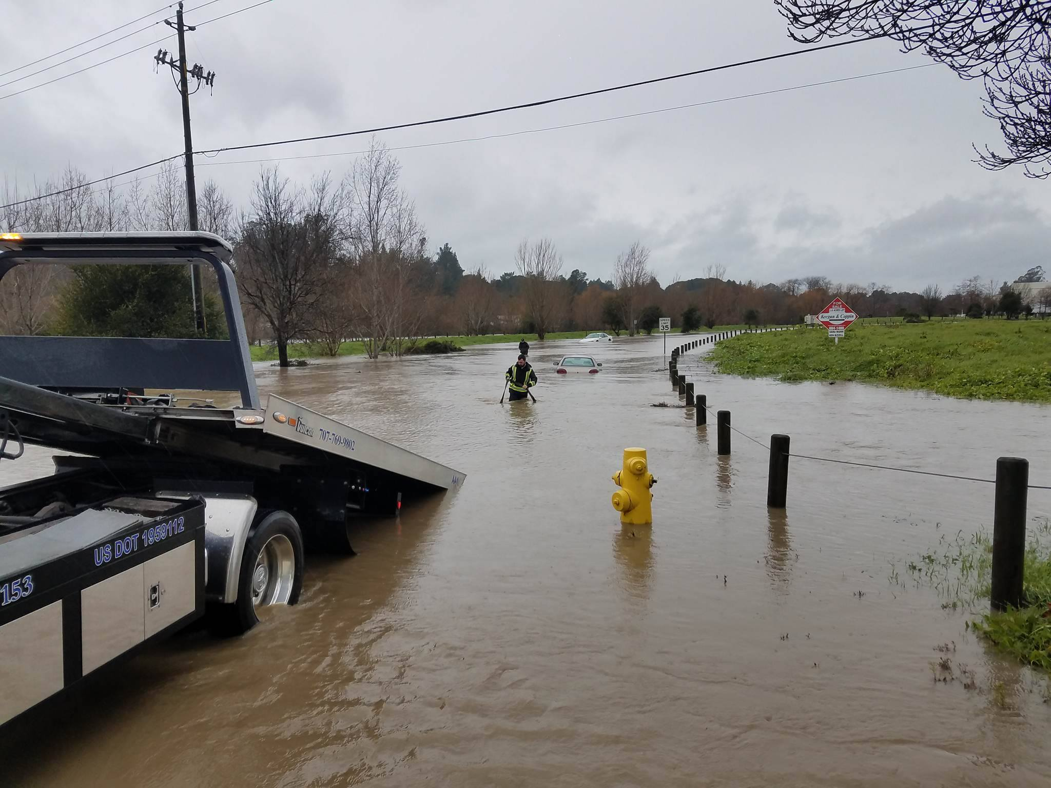 "<div class=""meta image-caption""><div class=""origin-logo origin-image none""><span>none</span></div><span class=""caption-text"">A car was towed away from flood waters in Petaluma on Jan. 8, 2017. (Cameron Reeder/Facebook)</span></div>"