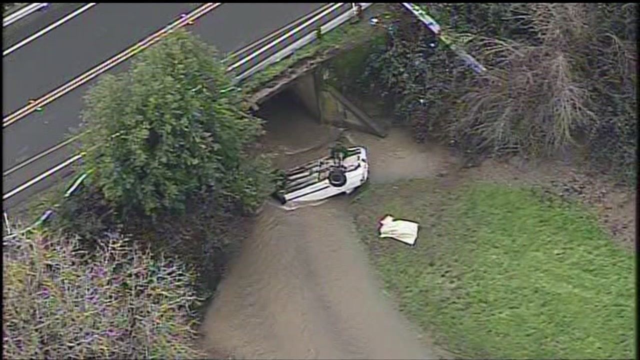 A car submerged in a Novato creek is seen on Monday January 9, 2017.
