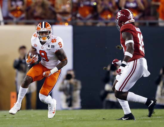 "<div class=""meta image-caption""><div class=""origin-logo origin-image ap""><span>AP</span></div><span class=""caption-text"">Clemson's Wayne Gallman runs against Alabama's Ronnie Harrison during the first half of the NCAA college football playoff championship game. (AP Photo/John Bazemore) (AP)</span></div>"