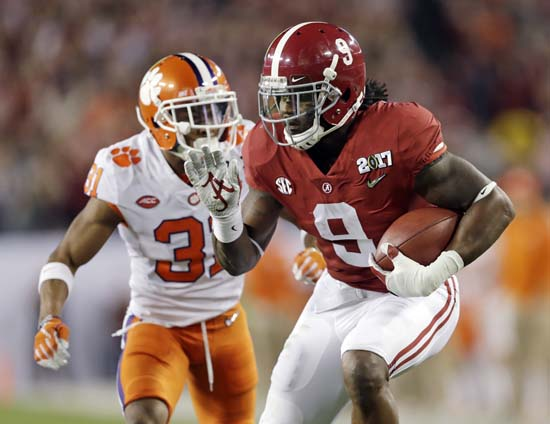 "<div class=""meta image-caption""><div class=""origin-logo origin-image ap""><span>AP</span></div><span class=""caption-text"">Alabama's Bo Scarbrough runs for a touchdown during the first half of the NCAA college football playoff championship game against Clemson. (AP Photo/Chris O'Meara) (AP)</span></div>"