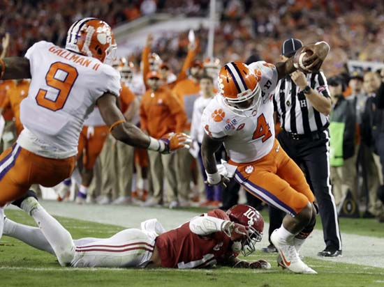 "<div class=""meta image-caption""><div class=""origin-logo origin-image ap""><span>AP</span></div><span class=""caption-text"">Clemson's Deshaun Watson runs for a touchdown during the first half of the NCAA college football playoff championship game against Alabama. (AP Photo/Chris O'Meara) (AP)</span></div>"