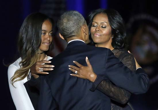 <div class='meta'><div class='origin-logo' data-origin='AP'></div><span class='caption-text' data-credit='AP'>President Barack Obama is joined by his First Lady Michelle Obama and his daughter Malia after giving his presidential farewell address. (AP Photo/Charles Rex Arbogast)</span></div>
