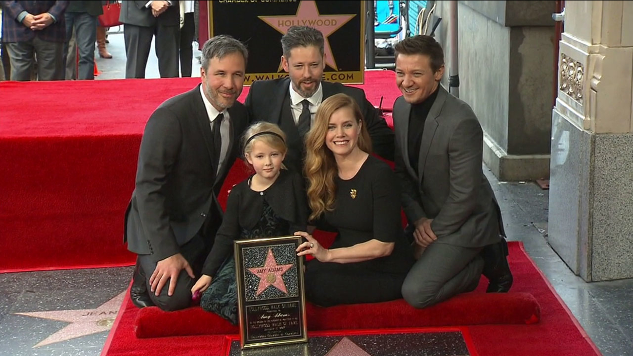 Amy Adams poses for a photo with her daughter, husband, director Denis Villeneuve and Jeremy Renner at her Hollywood Walk of Fame star on Wednesday, Jan. 11, 2017.