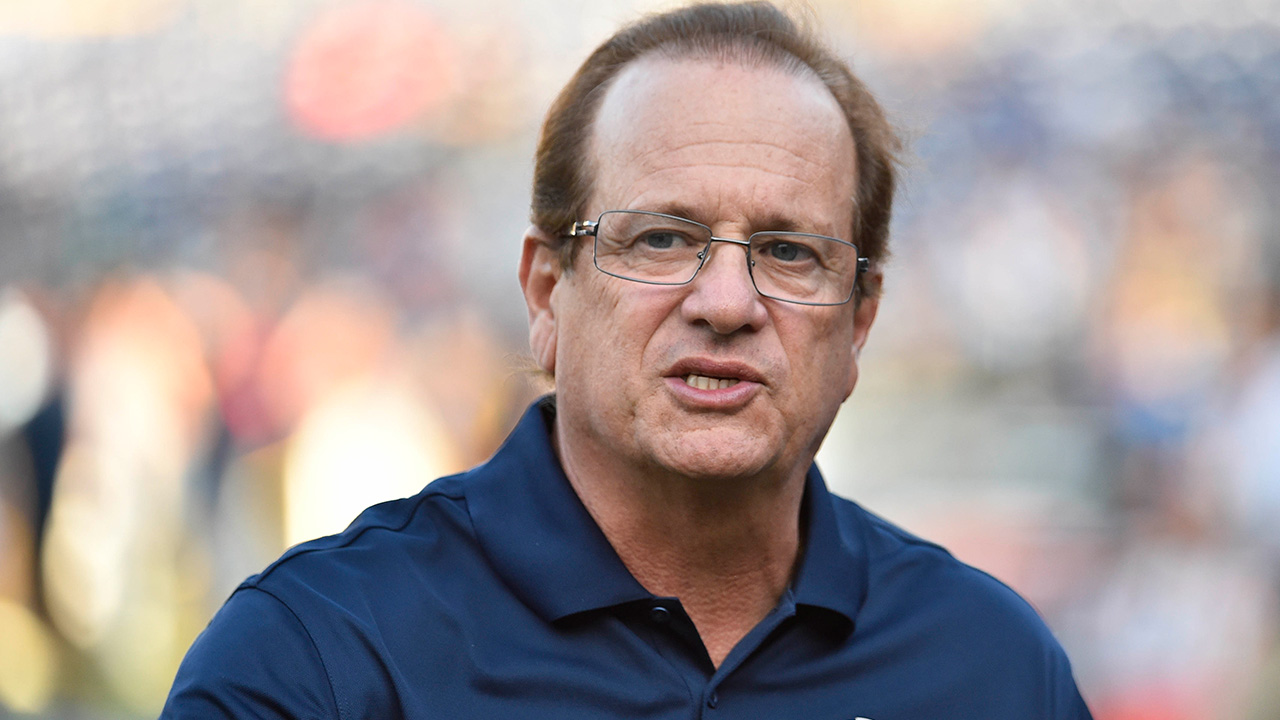 San Diego Chargers CEO Dean Spanos talks on the field before an NFL pre-season football game on Thursday, Aug. 7, 2014 in San Diego.