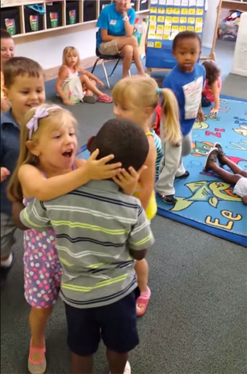 "<div class=""meta image-caption""><div class=""origin-logo origin-image ""><span></span></div><span class=""caption-text"">Tyler is welcomed back by his class after being out sich for a week with stomach flu. (Shawn Harris / YouTube)</span></div>"