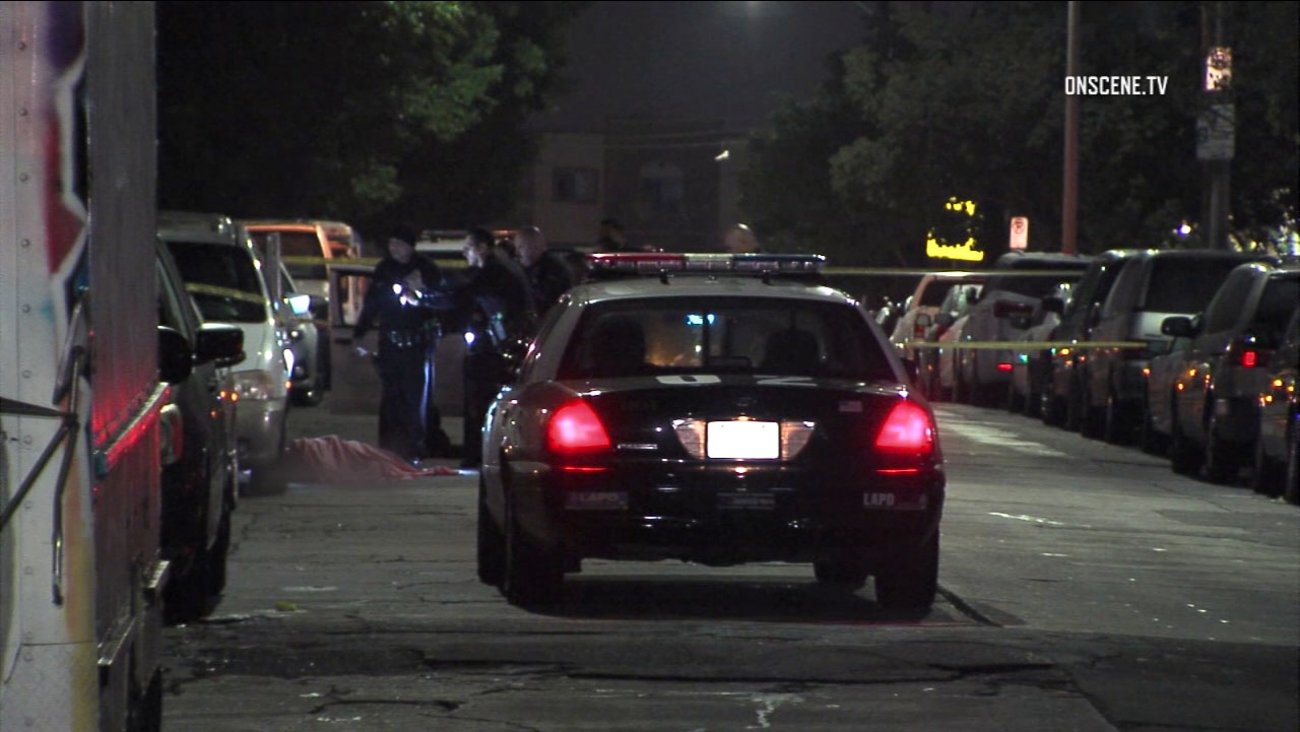 Los Angeles police investigate a deadly scene in the Westlake District area of Los Angeles on Friday, Jan. 13, 2017.