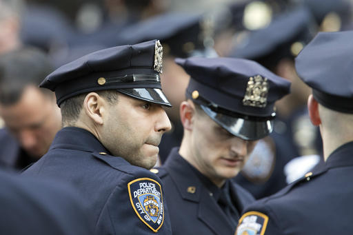<div class='meta'><div class='origin-logo' data-origin='AP'></div><span class='caption-text' data-credit=''>New York City police officers assemble on Fifth Avenue the before the start of the funeral service  (AP Photo/Mary Altaffer)</span></div>