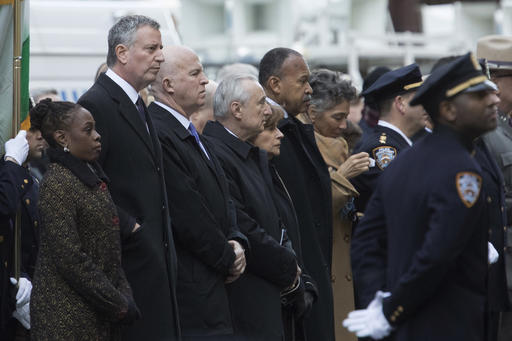 <div class='meta'><div class='origin-logo' data-origin='AP'></div><span class='caption-text' data-credit=''>Mayor Bill de Blasio, his wife Chirlane McCray, left, NYPD Commissioner James P. O'Neill third from left, and former Police Commissioner William Bratton,  (AP Photo/Mary Altaffer)</span></div>