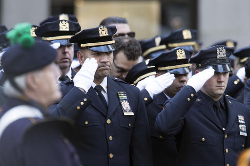 <div class='meta'><div class='origin-logo' data-origin='AP'></div><span class='caption-text' data-credit=''>Police officers salute as the funeral procession for New York City police officer Steven McDonald arrives at St. Patrick's Cathedral. (AP Photo/Mary Altaffer)</span></div>