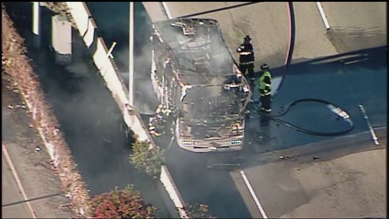 An RV burns on southbound Highway 101 near the San Francisco International Airport on Friday January 13, 2017.