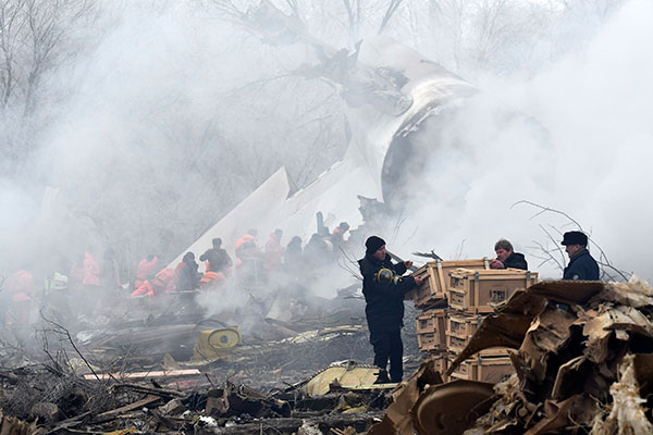 "<div class=""meta image-caption""><div class=""origin-logo origin-image none""><span>none</span></div><span class=""caption-text"">Kyrgyz Emergency Ministry officials work among remains of a crashed Turkish Boeing 747 cargo plane at a residential area outside Bishkek, Kyrgyzstan Monday, Jan. 16, 2017. (Vladimir Voronin/AP Photo)</span></div>"