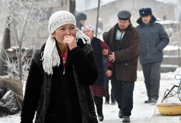 "<div class=""meta image-caption""><div class=""origin-logo origin-image none""><span>none</span></div><span class=""caption-text"">Relatives of victims of a crashed plane watch as Kyrgyz Emergency Ministry officials work among remains of a cargo plane at a residential area outside Bishkek, Kyrgyzstan. (Vladimir Voronin/AP Photo)</span></div>"