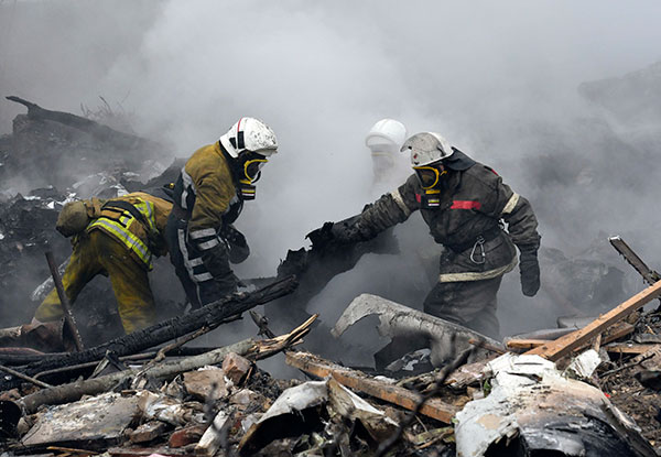"<div class=""meta image-caption""><div class=""origin-logo origin-image none""><span>none</span></div><span class=""caption-text"">Kyrgyz firefighters work among remains of a crashed Turkish Boeing 747 cargo plane at a residential area outside Bishkek, Kyrgyzstan Monday, Jan. 16, 2017. (Vladimir Voronin/AP Photo)</span></div>"