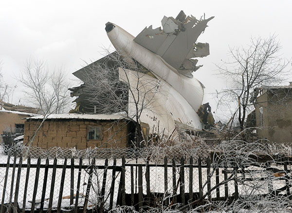 "<div class=""meta image-caption""><div class=""origin-logo origin-image none""><span>none</span></div><span class=""caption-text"">The tail of a crashed Turkish Boeing 747 cargo plane lies at a residential area outside Bishkek, Kyrgyzstan Monday, Jan. 16, 2017. (Vladimir Voronin/AP Photo)</span></div>"