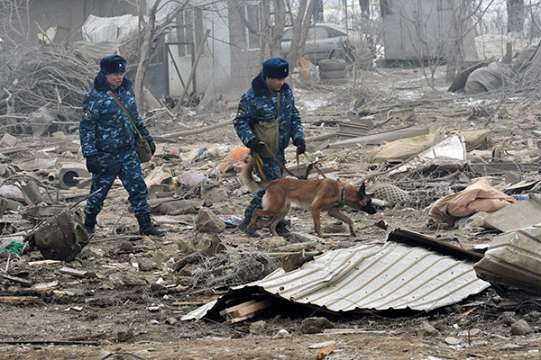"<div class=""meta image-caption""><div class=""origin-logo origin-image none""><span>none</span></div><span class=""caption-text"">Kyrgyz soldiers with a sniffer dog search among remains of a crashed Turkish Boeing 747 cargo plane at a residential area outside Bishkek, Kyrgyzstan Monday, Jan. 16, 2017. (Vladimir Voronin/AP Photo)</span></div>"