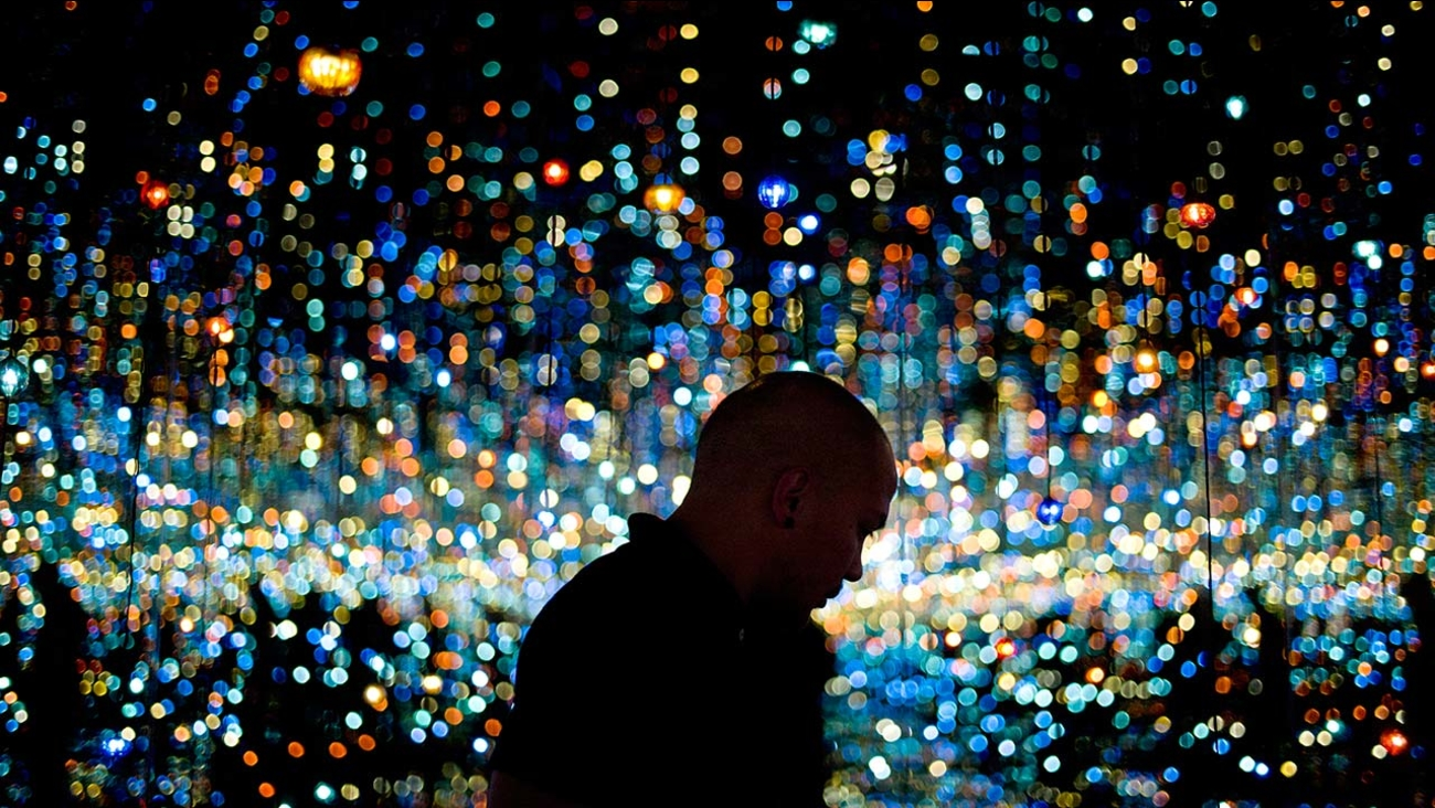 A visitor views Yayoi Kusama's Infinity Mirrored Room at the Broad Museum in downtown Los Angeles.