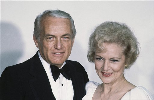 <div class='meta'><div class='origin-logo' data-origin='none'></div><span class='caption-text' data-credit='ASSOCIATED PRESS'>Actress Betty White with Ted Knight at the Emmy Awards in Los Angeles, Sept. 13, 1981. (AP Photo/Randy Rasmussen)</span></div>
