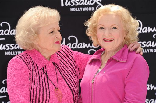 <div class='meta'><div class='origin-logo' data-origin='none'></div><span class='caption-text' data-credit='Katy Winn/Invision/AP'>Betty White, at left, attends her wax figure unveiling at Madame Tussauds on Monday, June 4, 2012 in Los Angeles. (Photo by Katy Winn/Invision/AP)</span></div>