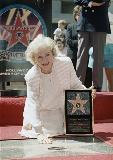 <div class='meta'><div class='origin-logo' data-origin='none'></div><span class='caption-text' data-credit='ASSOCIATED PRESS'>Betty White places her hand on the star that was presented posthumously to her husband, Allen Ludden, during ceremonies inducting him into the Hollywood Walk of Fame in Hollywood</span></div>